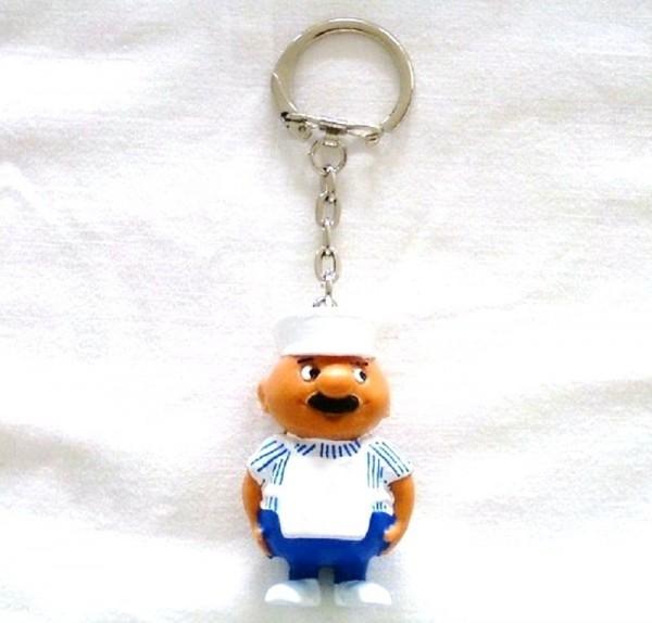 Schlüsselanhänger mit Sammelfigur Metzger aus Plastik