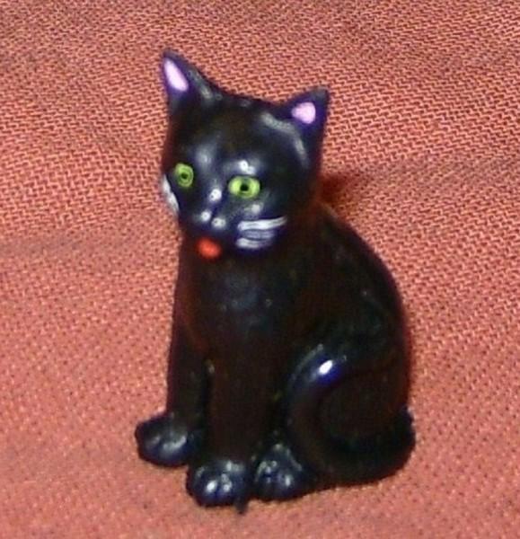 Katze schwarz, sitzend